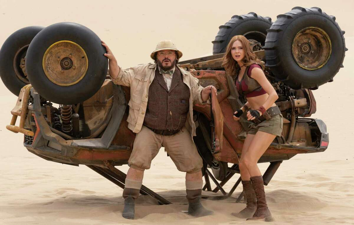 This image released by Sony shows Jack Black, left, and Karen Gillan in a scene from