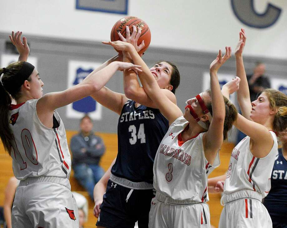 Staples Arianna Gerig puts up a shot against Greenwich's Bea Owens (10), Jordan Moses (3) and Julia Conforti (2) in the second half of an FCIAC girls basketball game at Staples High School on Jan. 24, 2020 in Westport, Connecticut. Staples defeated Greenwich 60-44. Photo: Matthew Brown / Hearst Connecticut Media / Stamford Advocate