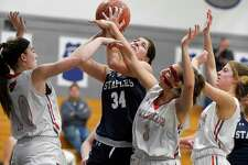 Staples Arianna Gerig puts up a shot against Greenwich's Bea Owens (10), Jordan Moses (3) and Julia Conforti (2) in the second half of an FCIAC girls basketball game at Staples High School on Jan. 24, 2020 in Westport, Connecticut. Staples defeated Greenwich 60-44.