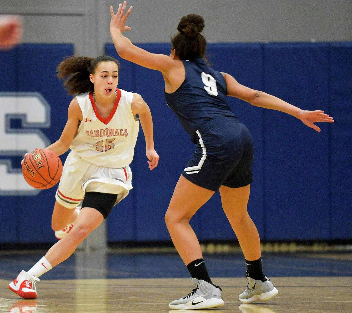 Greenwich's Makenzie Nelson (45) drives up the court against Staples Nicole Holmes (9) in the first half of an FCIAC girls basketball game at Staples High School on Jan. 24, 2020 in Westport, Connecticut. Staples defeated Greenwich 60-44.