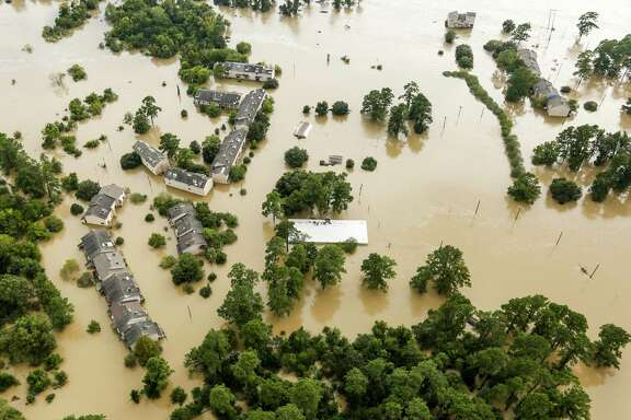 Floodwaters from the San Jacinto River inundate condominiums in the aftermath of Tropical Storm Harvey on Wednesday, Aug. 30, 2017, in Kingwood.