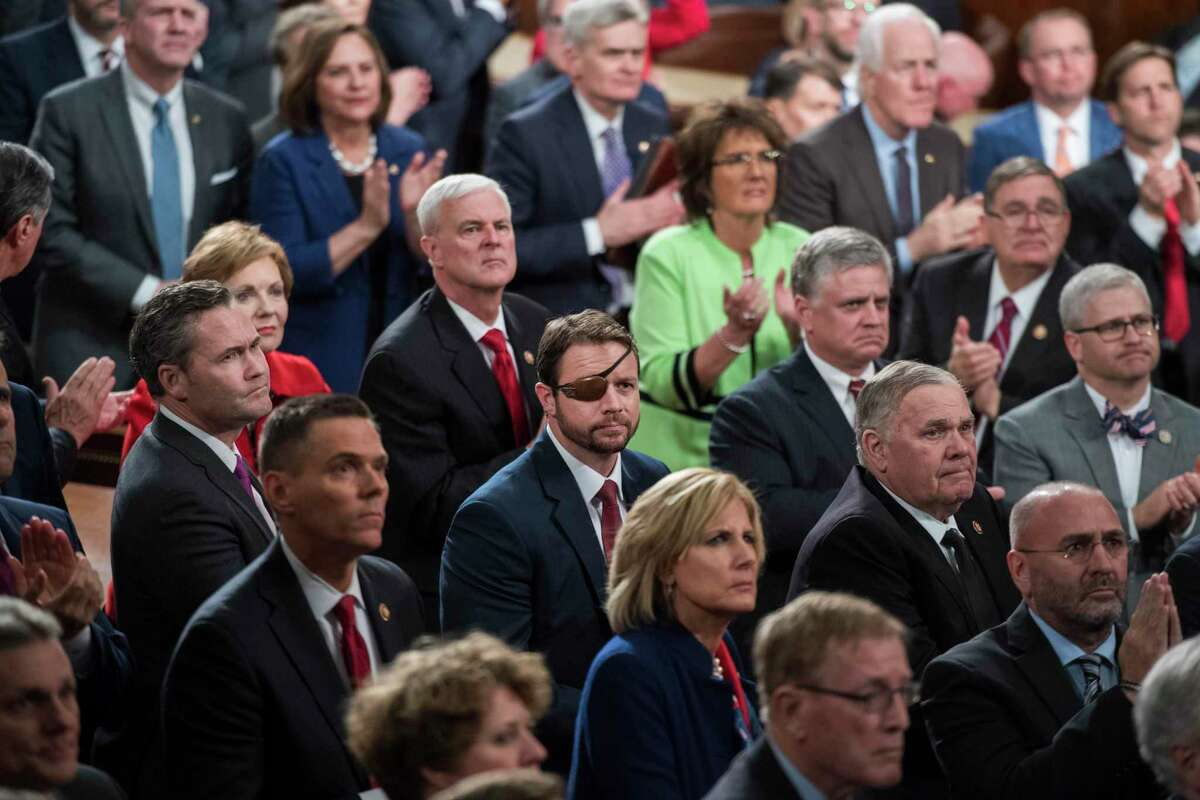 U.S. Rep. Dan Crenshaw, R-Texas, center, and House Republicans are seen in the House Chamber as President Donald Trump delivered his State of the Union address on Tuesday, February 5, 2019.