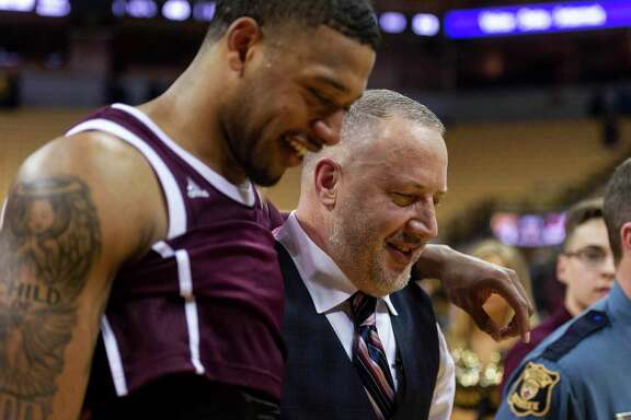 Texas A&M head coach Buzz Williams, right walks off the court with player Savion Flagg, left, after they defeated Missouri 66-64 in an NCAA college basketball game Tuesday, Jan. 21, 2020, in Columbia, Mo. (AP Photo/L.G. Patterson)