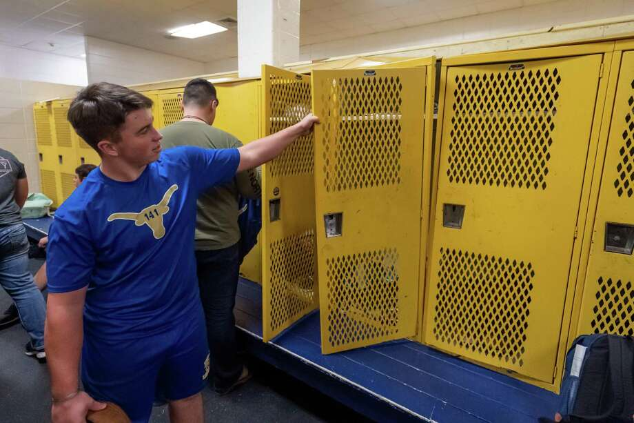 Junior Layne Werener, 16, pulls out the door and frame on his athletic locker. Hamshire-Fannett high school is in the final round of a national competition to win a new locker room. Unlike other competitors, the need for the district is rooted in the long recovery from Tropical Storm Harvey Photo made on January 24, 2020. Fran Ruchalski/The Enterprise Photo: Fran Ruchalski/The Enterprise / 2019 The Beaumont Enterprise