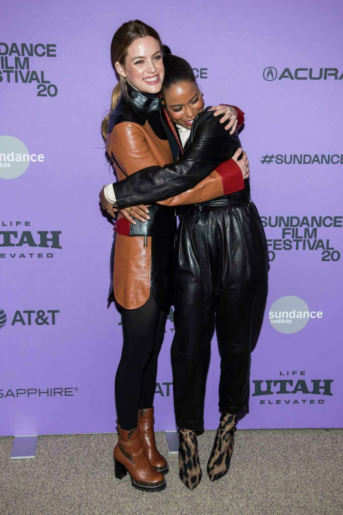 Riley Keough, left, and Taylour Paige attend the premiere of