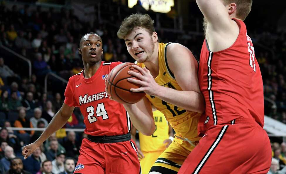 Siena forward Kyle Young (12) moves the ball against Marist defendersduring the first half of an NCAA basketball game Friday, Jan. 24, 2020, in Albany, N.Y. (Hans Pennink / Special to the Times Union) ORG XMIT: 012520_siena_HP105