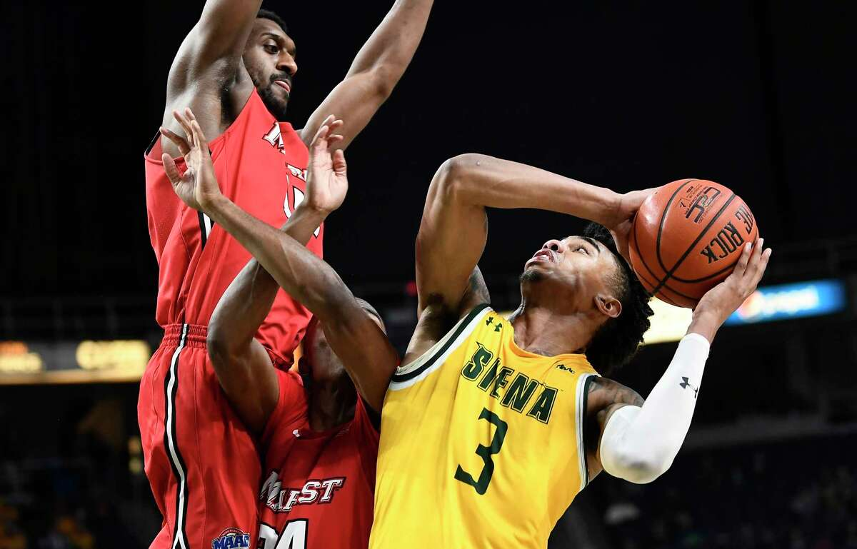 Siena guard Manny Camper (3) is fouled by Marist players during the second half of an NCAA basketball game Friday, Jan. 24, 2020, in Albany, N.Y. Siena won 70-57. (Hans Pennink / Special to the Times Union) ORG XMIT: 012520_siena_HP114