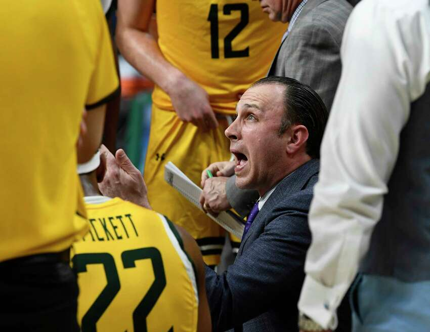 Siena head coach Carmen Maciariello instructs his players against Marist during the first half of an NCAA basketball game Friday, Jan. 24, 2020, in Albany, N.Y. (Hans Pennink / Special to the Times Union) ORG XMIT: 012520_siena_HP106