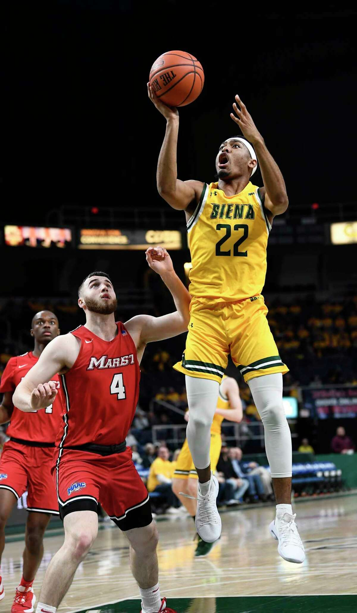 Siena guard Jalen Pickett (22) puts up a shot against Marist guard Tyler Sagl (4) during the second half of an NCAA basketball game Friday, Jan. 24, 2020, in Albany, N.Y. Siena won 70-57. (Hans Pennink / Special to the Times Union) ORG XMIT: 012520_siena_HP117