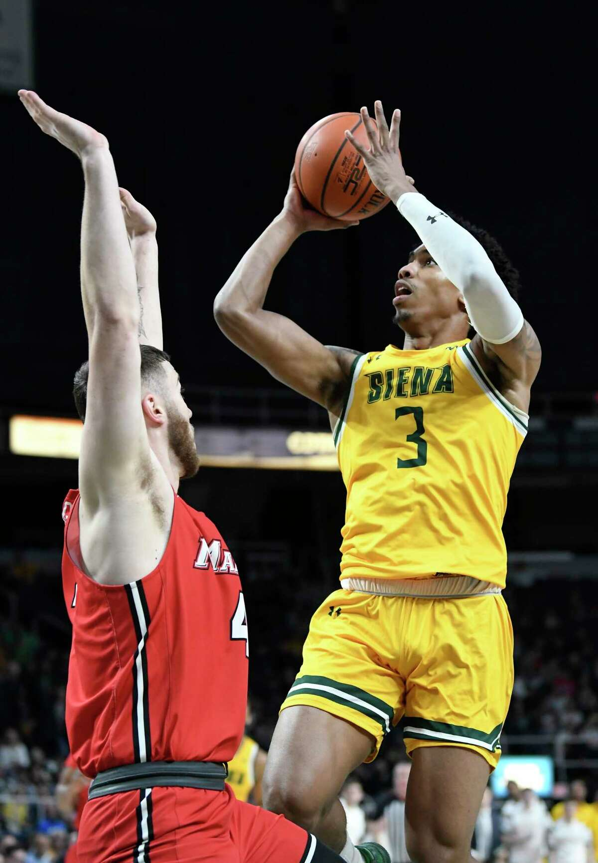 Siena guard Manny Camper (3) puts a shot over Marist guard Tyler Sagl (4) during the first half of an NCAA basketball game Friday, Jan. 24, 2020, in Albany, N.Y. (Hans Pennink / Special to the Times Union) ORG XMIT: 012520_siena_HP109