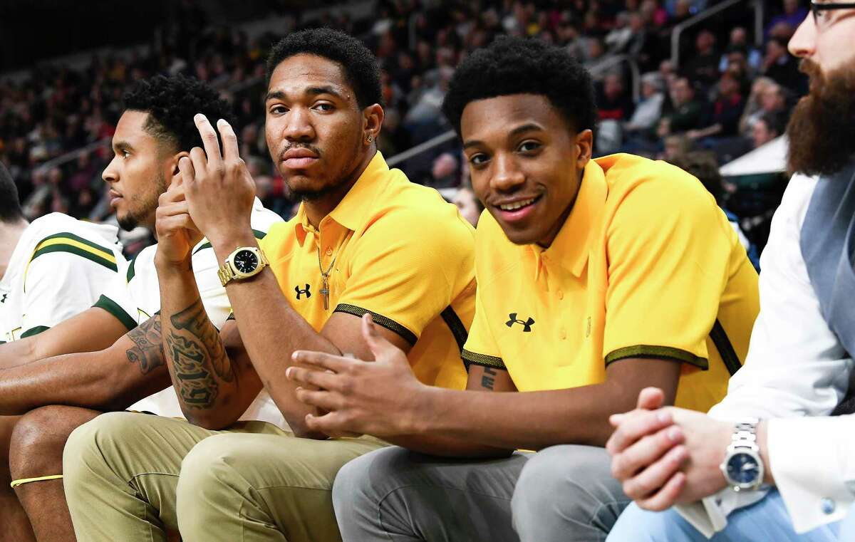 Siena players Dana Tate ,left, and Aiden Carpenter watch teammates play Marist during the first half of an NCAA basketball game Friday, Jan. 24, 2020, in Albany, N.Y. (Hans Pennink / Special to the Times Union) ORG XMIT: 012520_siena_HP118