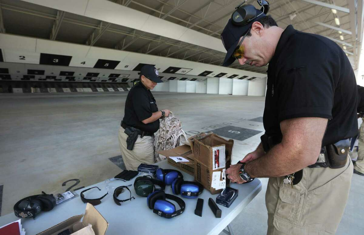 Members of the Texas A&M University San Antonio Police Department Susan Gonzales, left, and Jeff Grossman, right, prepare for shooting practice at the Bexar County Firing Range, Friday, August 30, 2013. In January 2020, the Galveston City Council rolled back regulations on firing ranges and gun shops after the Texas attorney general advised they violated state law.