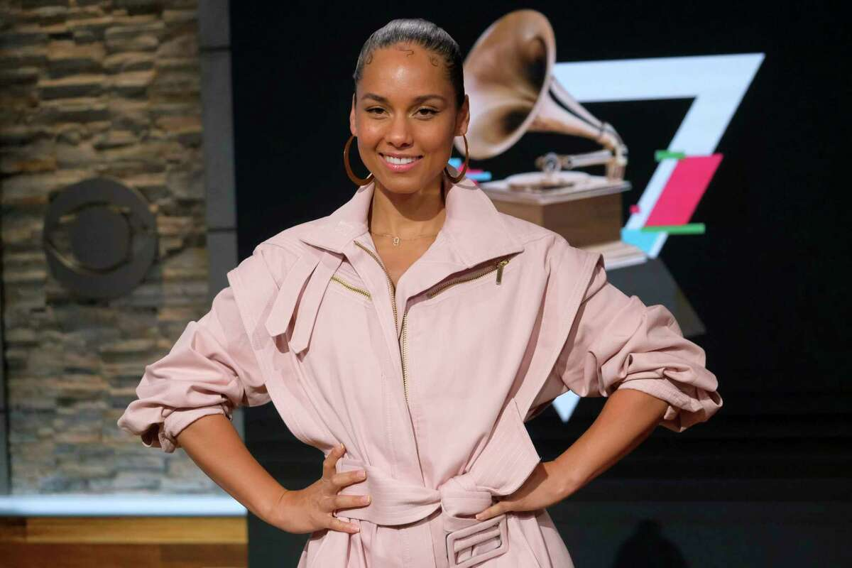 FILE - This Nov. 20, 2019 file photo shows Alicia Keys at the 62nd Grammy Awards nominations press conference in New York. Keys returns as host of the annual music awards show on Sunday. (Photo by Charles Sykes/Invision/AP, File)