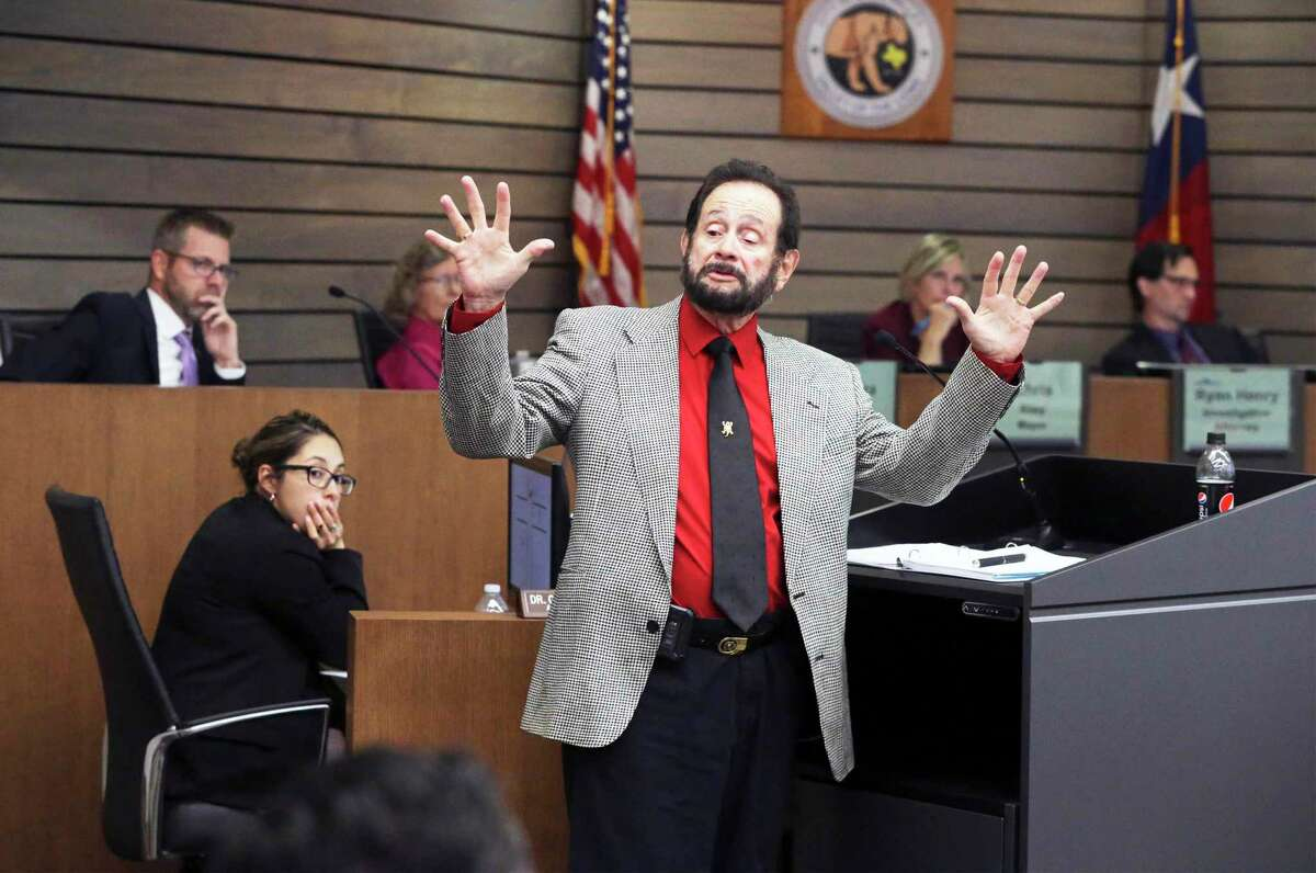 The council member demonstrates his reaction in an encounter with police which is part of the points under consideration as he takes the stand in his own behalf as testimony continues in the forfeiture hearing of Councilor Benny Martinez at the Leon Valley Council Chambers on August 8, 2019.