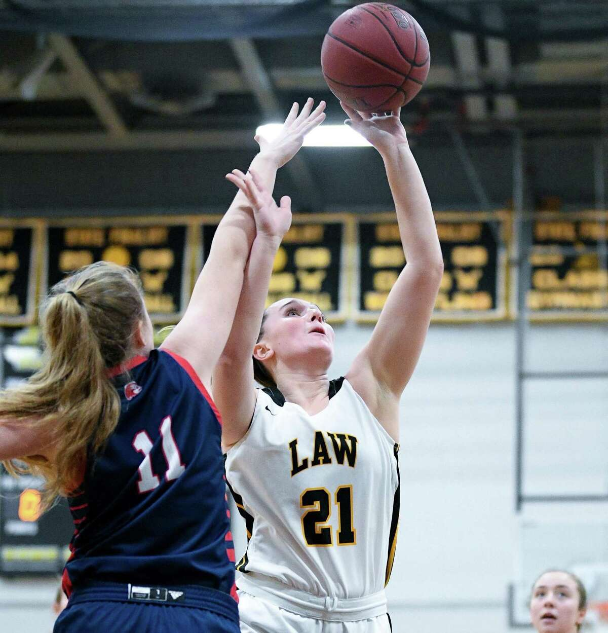 Jill Hall had a double-double with 10 points and 10 rebounds when Law defeated Foran.