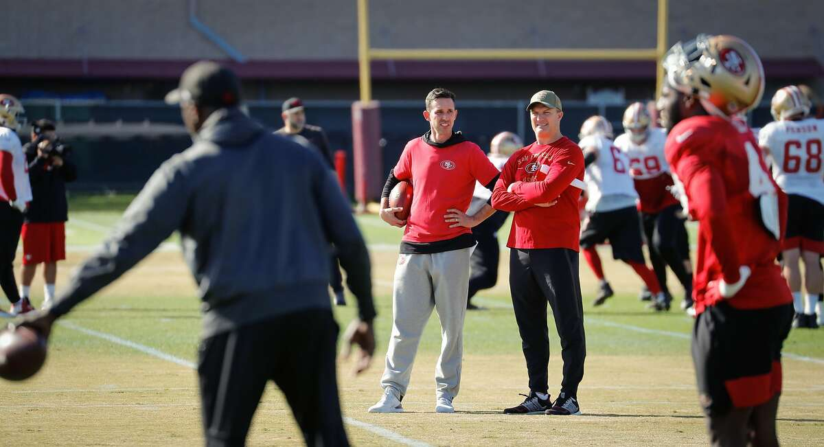 49ers head coach Kyle Shanahan general manager John Lynch watch over the defense during practice at 49ers headquarters on Friday, Jan. 24, 2020 in Santa Clara, Calif.