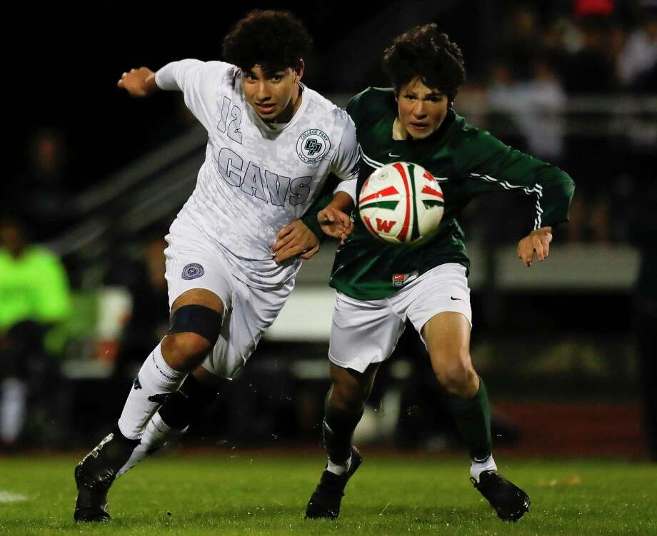 College Park midfielder Mauricio Sanchez (12) battles for the ball against The Woodlands midfielder Cody Tice (13) during the first period of a District 15-6A high school soccer match at The Woodlands High School, Friday, Jan. 24, 2020, in The Woodlands. Photo: Jason Fochtman, Houston Chronicle / Staff Photographer / Houston Chronicle © 2020