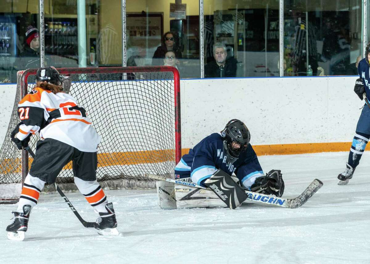 Goalie Erin McMorris makes a save during Wilton's 3-2 win over Ridgefield on Friday.