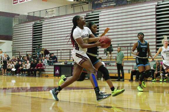 Pearland's De'Yona Gaston (33), shown in a game earlier this year against Shadow Creek, scored 32 points, pulled down 19 rebounds and blocked two shots in the Lady Oilers' 51-31 win over George Ranch Friday night.