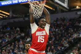 Houston Rockets center Clint Capela yells after dunking the ball against the Minnesota Timberwolves during the second half of an NBA basketball game Friday, Jan. 24, 2020, in Minneapolis. (AP Photo/Craig Lassig)