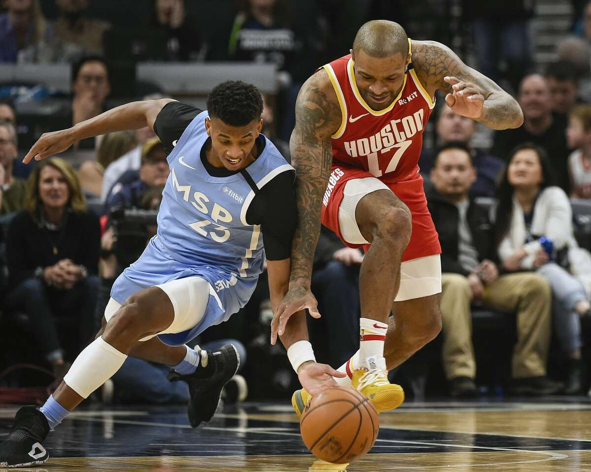 Minnesota Timberwolves guard Jarrett Culver, left, and Houston Rockets forward P.J. Tuckerbattle for a loose ball during the second half of an NBA basketball game Friday, Jan. 24, 2020, in Minneapolis. The Rockets won 131-124.(AP Photo/Craig Lassig)