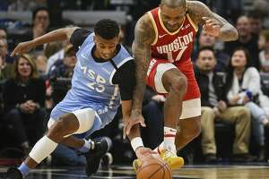 Minnesota Timberwolves guard Jarrett Culver, left, and Houston Rockets forward P.J. Tucker battle for a loose ball during the second half of an NBA basketball game Friday, Jan. 24, 2020, in Minneapolis. The Rockets won 131-124.(AP Photo/Craig Lassig)