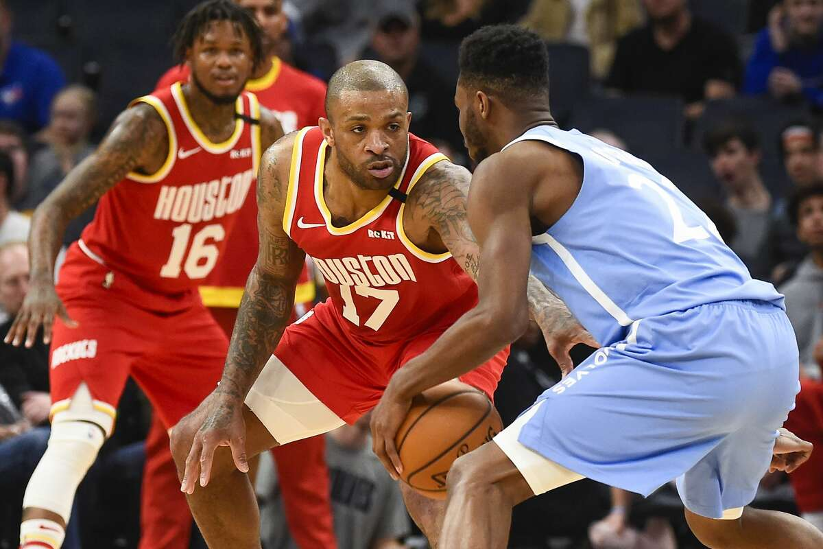 Houston Rockets forward P.J. Tucker(17) defends against Minnesota Timberwolves forward Andrew Wigginsas he tries to drive to the basket during the second half of an NBA basketball game Friday, Jan. 24, 2020, in Minneapolis. (AP Photo/Craig Lassig)