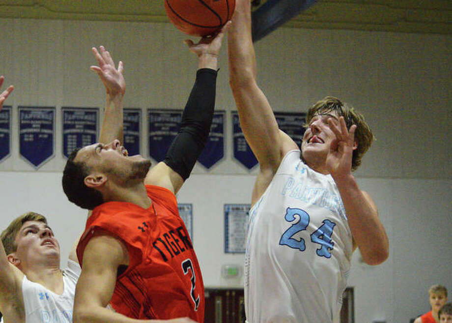 Edwardsville's Ethan Young, left, and Jersey's Matthew Jackson battle for a rebound during the second quarter of Friday's game at the Jersey Mid-Winter Classic. Photo: Scott Marion   For The Telegraph