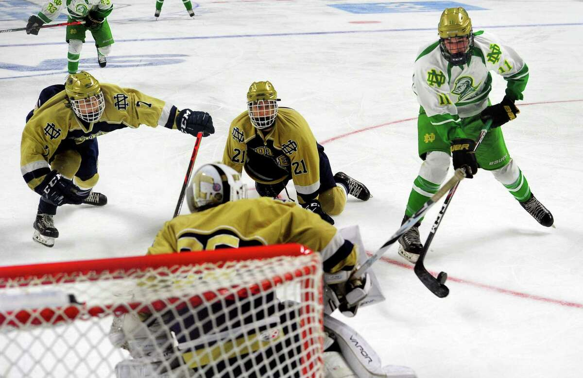 Notre Dame of West Haven's Ryan Cannon (11), right, attempts to score against Notre Dame of Fairfield during Connecticut Ice Tournament action at the Webster Bank Arena in Bridgeport, Conn., on Jan. 24, 2020.