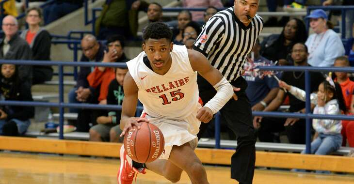 Tyrell Palmer (15) of Bellaire drives down-court during the third quarter of a 6A Region III District 18 boys basketball game between the Bellaire Cardinals and the Lamar Texans on Friday, January 24, 2020 at Butler Stadium, Houston, TX.