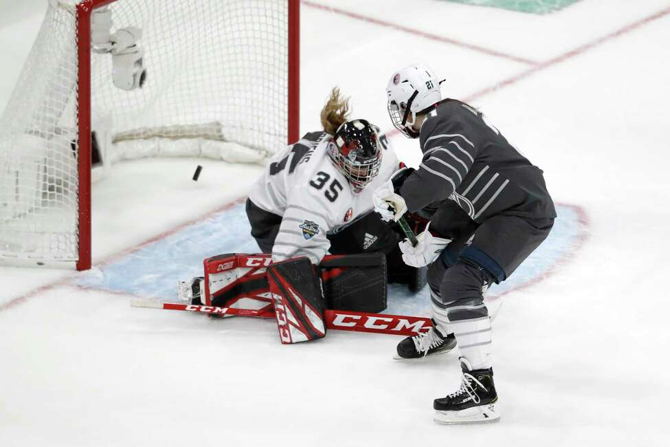 United States' Hilary Knight (21) scores against Canada goalie Ann-Renee Desbiens (35) during the second period in the elite women's 3-on-3 game, part of the NHL All-Star weekend, Friday, Jan. 24, 2020, in St. Louis. (AP Photo/Jeff Roberson)