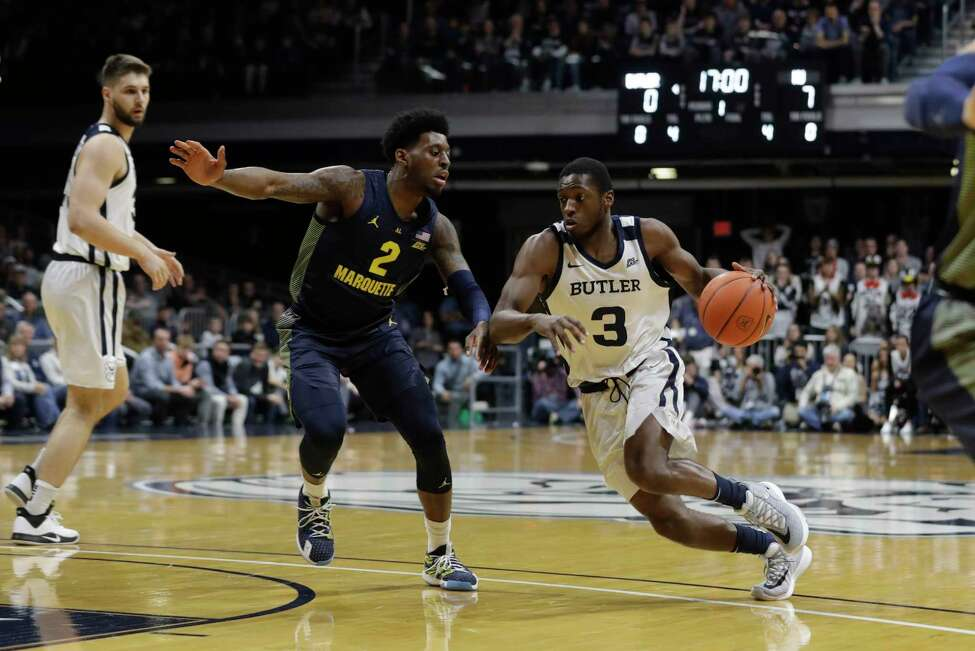 Butler's Kamar Baldwin (3) goes to the basket against Marquette's Sacar Anim (2) during the first half of an NCAA college basketball game, Friday, Jan. 24, 2020, in Indianapolis. (AP Photo/Darron Cummings)