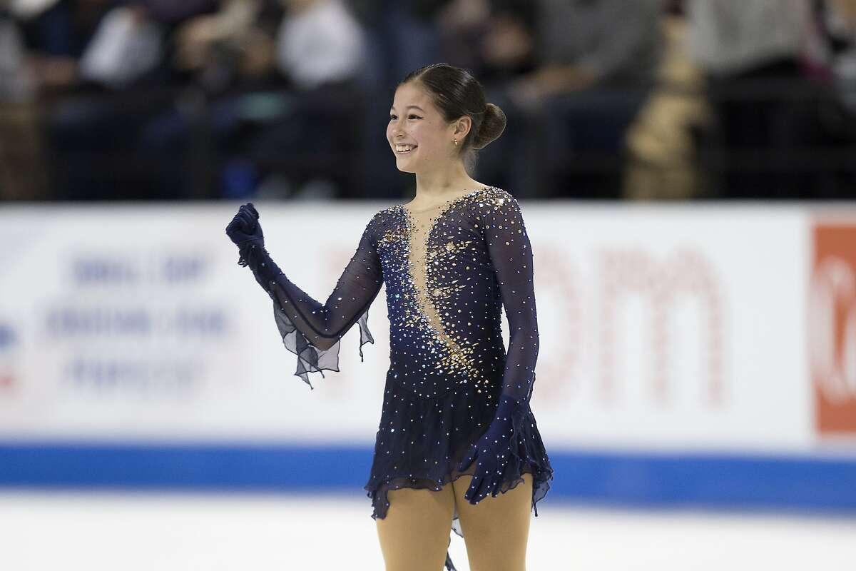 Alysa Liu gives a fist-pump upon competing her senior women's free skate program at the U.S. Figure Skating Championships, Friday, Jan. 24, 2020, in Greensboro, N.C. (AP Photo/Lynn Hey)