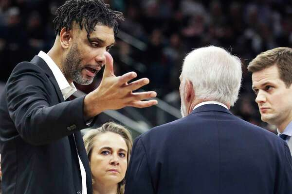 Tim Duncan talks with coaches during a timeout as the Spurs host Phoenix at the AT&T Center on Jan.24, 2020.