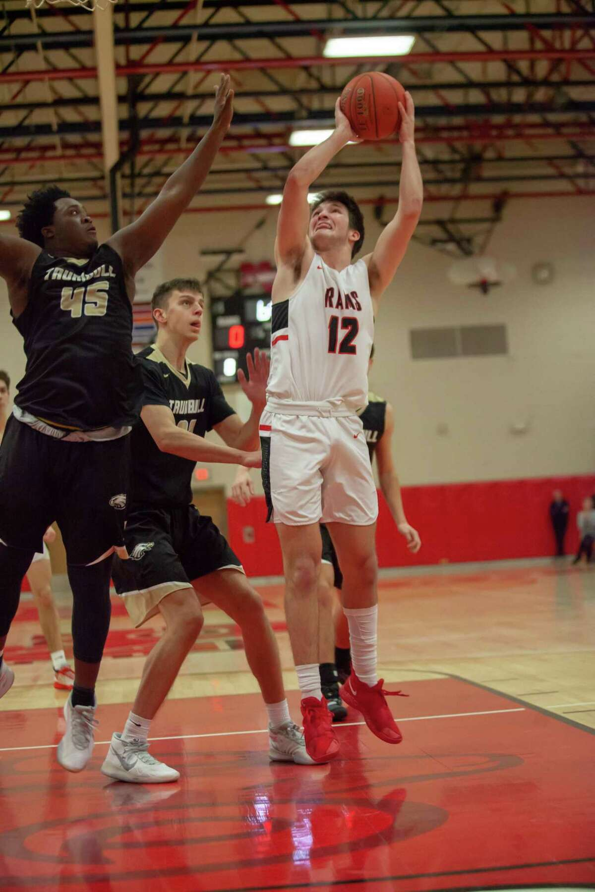 Trumbull's Quentar Taylor (45) defends against New Canaan's Christian Sweeney (12) in a boys basketball game on Friday, Jan. 24, 2020.