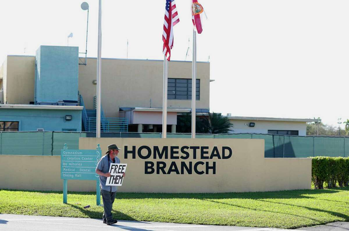 FILE - In this Feb. 19, 2019 file photo, Josh Rubin demonstrates in front of the Homestead Temporary Shelter for Unaccompanied Children, in Homestead, Fla.