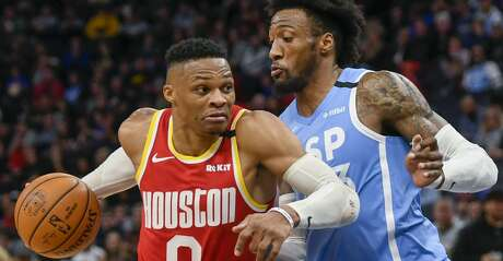 Houston Rockets guard Russell Westbrook drives past Minnesota Timberwolves forward Robert Covington during the second half of an NBA basketball game Friday, Jan. 24, 2020, in Minneapolis. The Rockets won 131-124. (AP Photo/Craig Lassig)