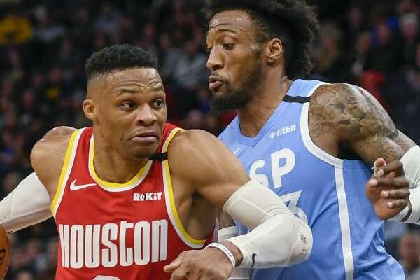 Houston Rockets guard Russell Westbrook drives past Minnesota Timberwolves forward Robert Covington during the second half of an NBA basketball game Friday, Jan. 24, 2020, in Minneapolis. The Rockets won 131-124. (AP Photo/Craig Lassig)