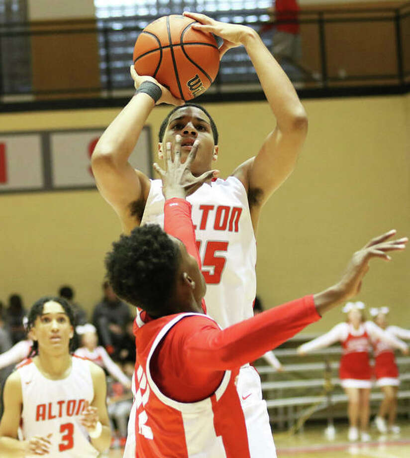 Alton's Dante' Herrin shoots over a Centralia defender in a Dec. 28 game at the Centralia Tournament. On Friday night at the Belleville East Chick-fil-A Tourney in Belleville, Herrin scored 15 points in a semifinal loss to unbeaten Collinsville. Photo: Greg Shashack / The Telegraph