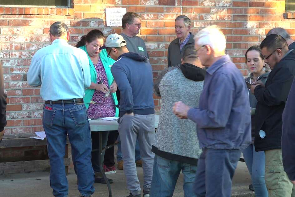 Volunteers pitch in Saturday morning to help homeowners whose houses were damaged from the West Houston explosion.