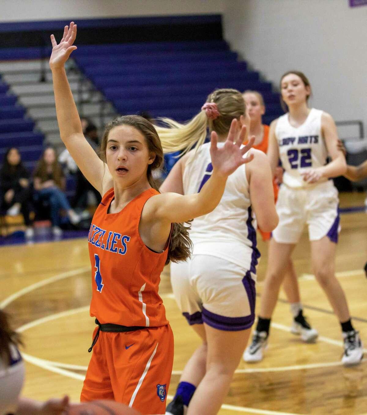 Grand Oaks guard Lauren Moylan (1) prepares to block a pass from Willis high school during a junior varsity high school basketball match, Tuesday, Jan. 21, 2020, in Willis.