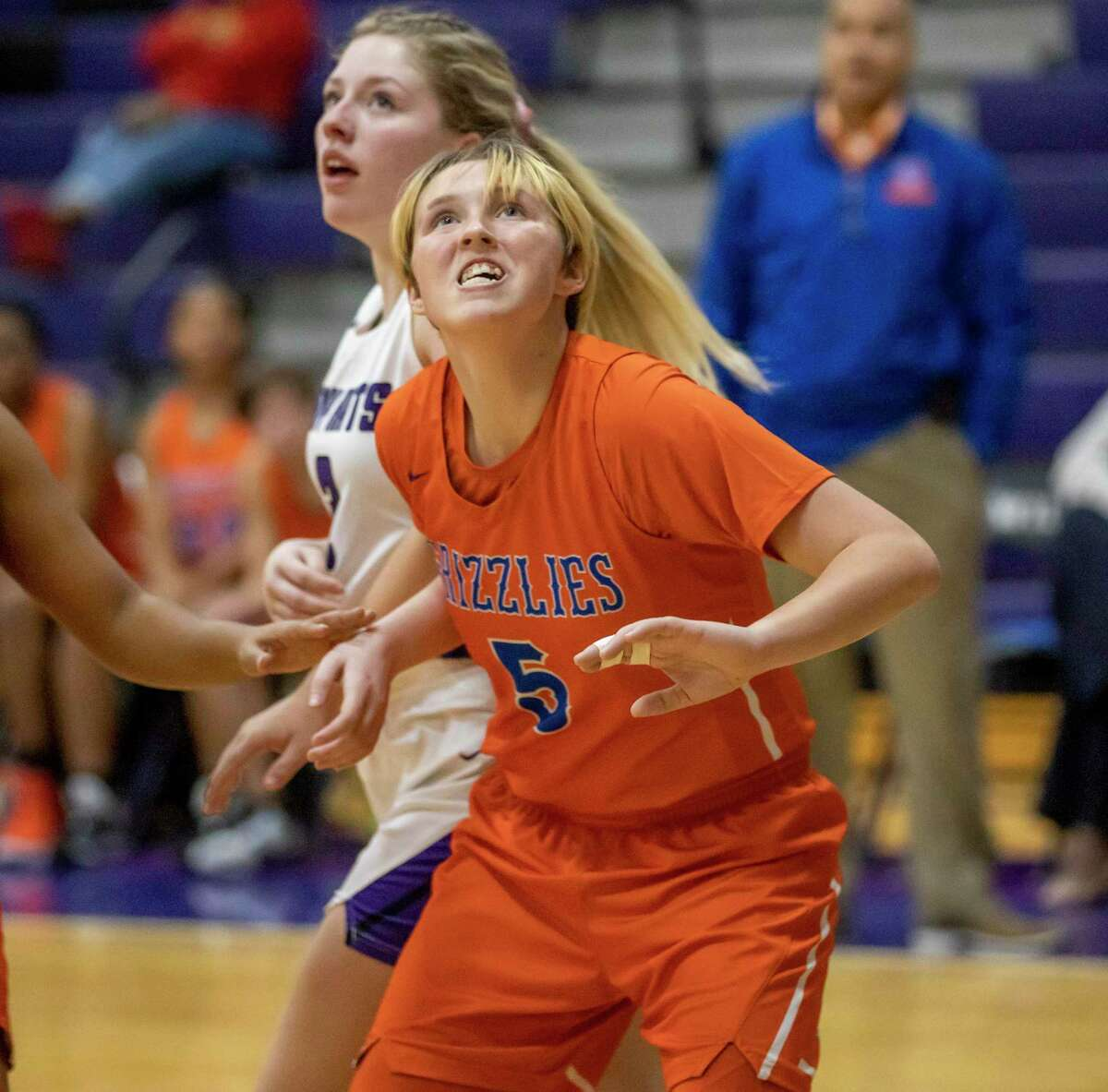 Grand Oaks post Amber Morgan (5) watches the ball after she shoots for the basket during a junior varsity high school basketball match against Willis high school, Tuesday, Jan. 21, 2020, in Willis.