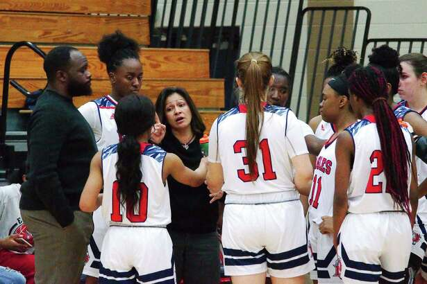 Dawson basketball coach Isabel Gomez speaks to her team during a timeout against Alief Elsik Friday at Dawson High School.