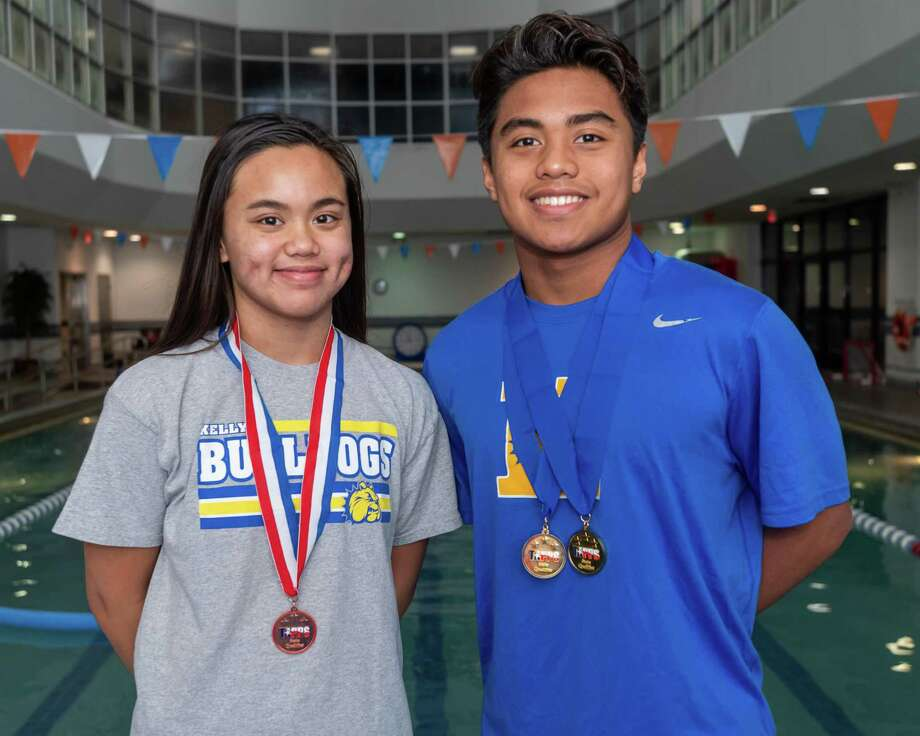 Kelly Catholic swimmers, sister and brother Kelsy and Keith Elgar stand for a portrait before jumping in the pool for practice at the Christus Health and Wellness Center on January 23, 2020. Fran Ruchalski/The Enterprise Photo: Fran Ruchalski/The Enterprise / 2019 The Beaumont Enterprise