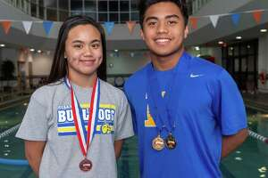 Kelly Catholic swimmers, sister and brother Kelsy and Keith Elgar stand for a portrait before jumping in the pool for practice at the Christus Health and Wellness Center on January 23, 2020. Fran Ruchalski/The Enterprise
