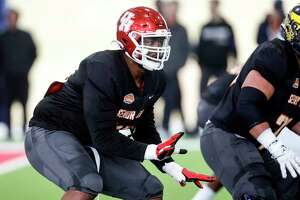 North offensive tackle Josh Jones of Houston (70) participates in drills as the North squad practices for the Senior Bowl Thursday, Jan. 23, 2020, in Mobile, Ala. (AP Photo/Butch Dill)