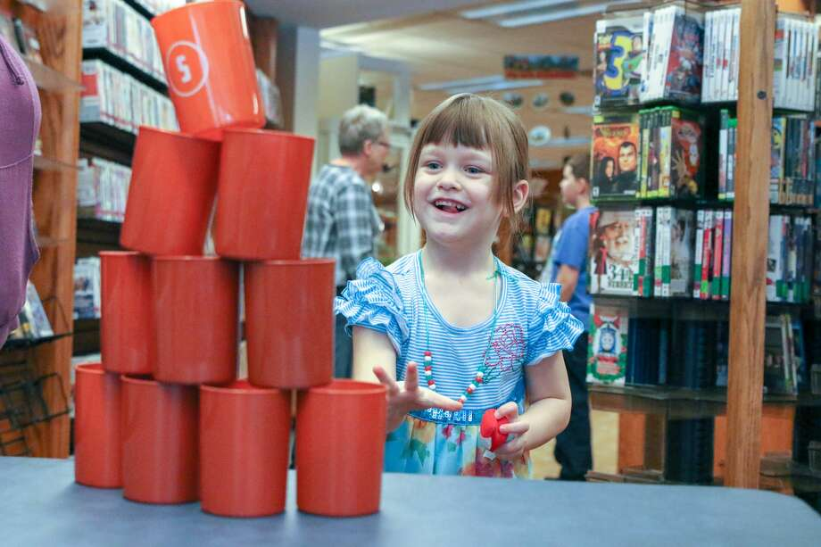 Children participate in a number of events at the Bad Axe District Library Saturday during its indoor picnic. Photo: Eric Young/Huron Daily Tribune
