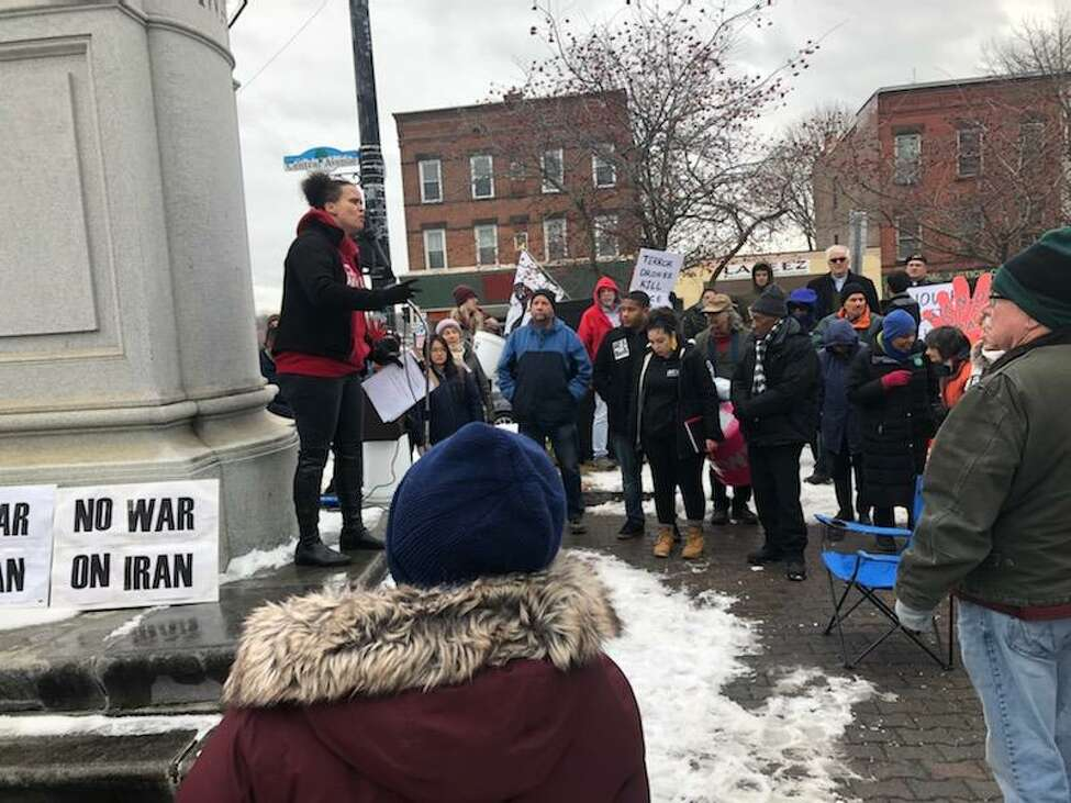 Jamaica Miles with Citizen Action New York addresses the crowd of protesters at Townsend Park in Albany on Saturday morning.