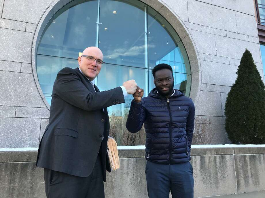 Criminal Defense Attorney Allan Friedman and Emmanuel Mong fist bump in celebration of larceny and conspiracy charges being thrown out against Mong at the Stamford courthouse Tuesday morning. Photo: John Nickerson / Hearst Connecticut Media