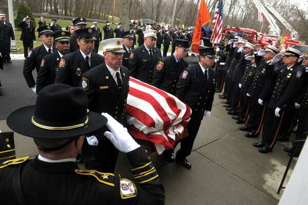 The funeral mass for Orange Fire Marshal Tim Smith at Holy Infant Church, in Orange, Conn. Jan 25, 2020. Smith was killed in a motor vehicle accident last Sunday returning from a fire.